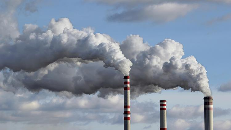 Companies in California and Quebec were expected to spend $908 million on a cap-and-trade auction held Tuesday that essentially operates as California's penalty for pollution.