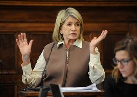 Martha Stewart, founder of Martha Stewart Living Omnimedia Inc., has settled her lawsuit with Macy's. Here, she is seen testifying.