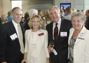 Marshall Taylor, United Way board chairwoman and honoree Debbie Taylor pose with Pat and Rachael Faubion.