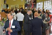 Attendees network at the event at Brickell Motors in Miami.
