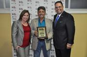 Melanie Dickinson; Gus Exposito Sr. with Z Roofing and Waterproofing; and Mario Murgado.