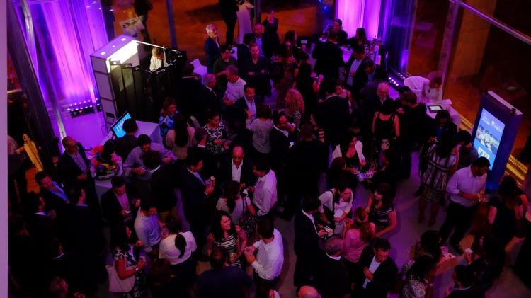 Guests mingle at the kickoff event for the 2015 eMerge Americas conference.