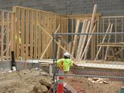 Construction workers were on the job for one of the condo units in phase one of Mercer Commons on Mercer Street.