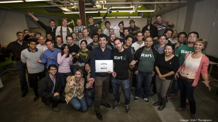 StartX CEO Cameron Teitelman, playing air guitar at center, with a few of StartX's 450 founders and friends.