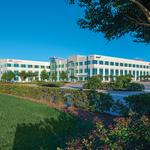 Local real estate firm buys another northern Houston office building