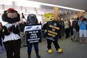 Wu joined in the welcome with other local mascots in the terminal.