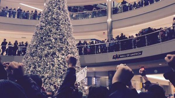 Hundreds of civil rights protesters and onlookers filled the Mall of America rotunda Saturday afternoon.