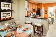 The kitchen and dining area of a unit in the redeveloped Uplands.