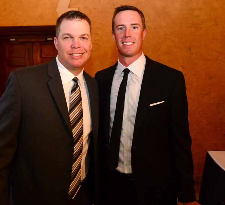 Recently retired Atlanta Braves great Chipper Jones, left, with Atlanta Falcons  quarterback Matt Ryan. Jones was awarded the Lifetime Achievement Award presented by The Coca-Cola Co. Ryan was named pro athlete of the year.