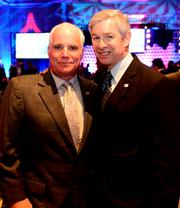 Mike Smith, head coach of the Atlanta Falcons, with Mark Becker, president of GSU. Smith was named coach of the year.