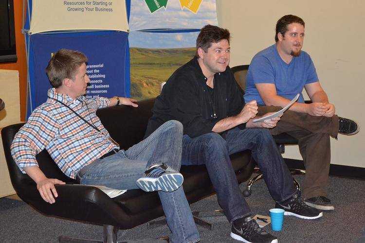 Judges Richard Stevens, Mark Janzen and Dominic Flask give feedback to the teams at Wichita's first Startup Weekend in May. All three will be coaches at October's event, where judges will include Devin Walker and Justin McClure.