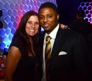Sandra Golden, sports radio personality at 680 The Fan, with Warrick Dunn, former Atlanta Falcon running back.