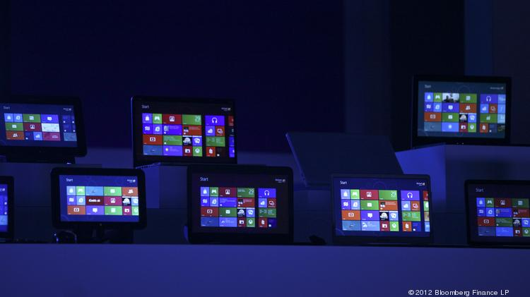 The Windows 8 software homepage is displayed on tablet devices at the Microsoft Corp. Windows 8 software consumer preview event at the Mobile World Congress in Barcelona, Spain.