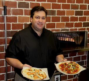 Mike Sims, the local franchisee of Your Pie, a new fast casual restaurant.