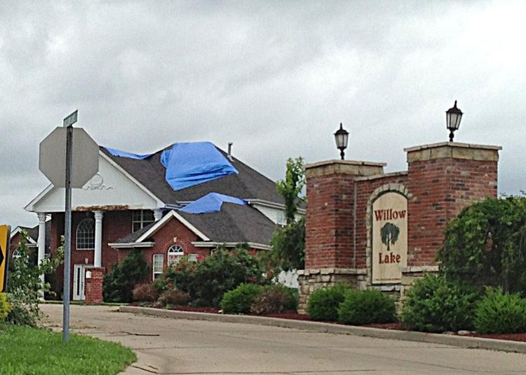 Tarps cover roof damage in the Willow Lake subdivision.