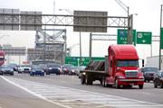 Southbound Interstate 75 traffic exits the Brent Spence Bridge in Covington, Ky. Rush hour slows the pace. An estimated 1.6 million gallons of fuel are wasted annually due to traffic congestion, which ‑ under current conditions – will increase to 5.7 million gallons per year in 2030.