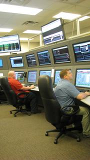 David Waters (left) and  Sam Sparks keep an eye on operations in Cliffside's control room.