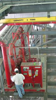 A Duke worker performs routine maintenance on a fire-protection booster pipe at Cliffside.