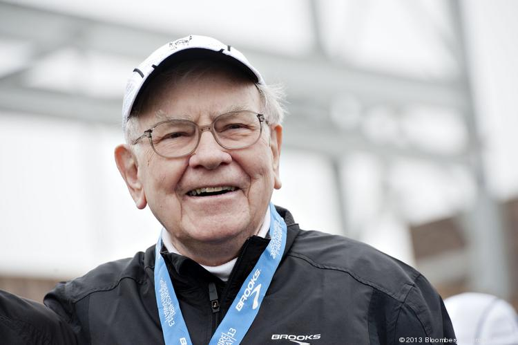 """Warren Buffett, chairman and chief executive officer of Berkshire Hathaway, Inc., smiles during the awards ceremony for the """"Berkshire Hathaway Invest In Yourself 5K"""" race presented by Brooks Sports, Inc., a Berkshire company, in Omaha, Nebraska, U.S., on Sunday, May 5, 2013. Warren Buffett, the leader of Berkshire Hathaway since the 1960s, said the company's next chief executive officer will bolster the company's reputation as a source of stability in times of crisis. Photographer: Daniel Acker/Bloomberg *** Local Caption *** Warren Buffett"""