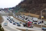 "Northbound Interstate 75 traffic descends the ""Cut in the Hill"" as it approaches the Brent Spence Bridge. The OKI Regional Council of Governments says 75 percent of jobs in the region are within 5 miles of Interstate 75."