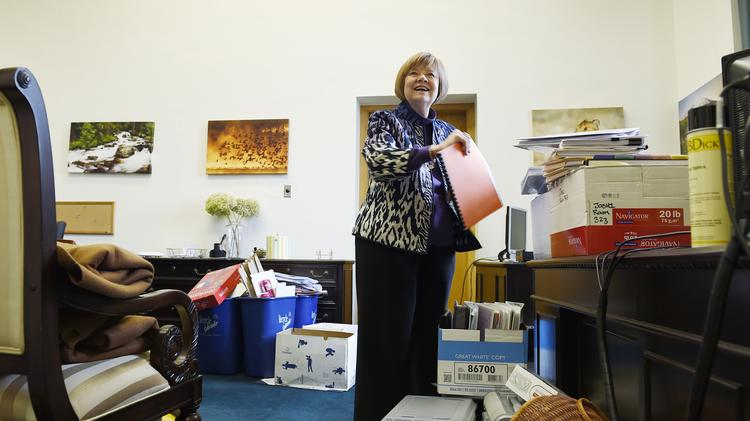 House Speaker-designee Dickey Lee Hullinghorst unpacking in her new office at the capitol.