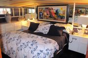 The master stateroom aboard the Christine K, owned by Jim and Christine Warjone, features built-ins.