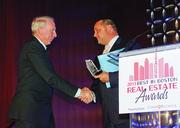 Joseph Fallon, CEO and president of The Fallon Company, which is developing the 21-acre Fan Pier project in Boston's Seaport district, received the event's Visionary Award from BBJ Publisher Chris McIntosh. More photos.