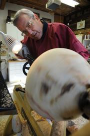 Sam Williams demonstrating his wood turning hobby for an Atlanta Business Chronicle feature in 2008.