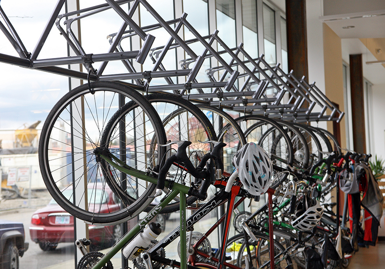 Jama Software employees' bikes hang in the office window along Northwest Marshall Street.