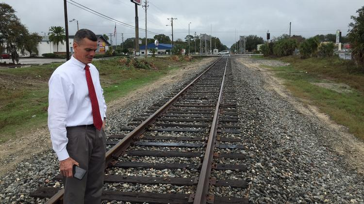 Mark Sharpe, shown here by the railroad tracks near the corner of Fowler and Nebraska avenues, has taken the leadership role in the Tampa Innovation Alliance, which holds its kickoff event Friday on the USF campus.