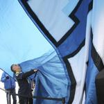 12th Man flag rises once more above Seattle (slideshow)