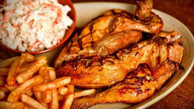 A plate of chicken, fries and slaw from Nando's.