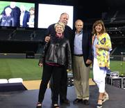From left, Kathy Holmgren, Mike Holmgren, Andy Hutchison and Susan Hutchison, all co-chairs of the Medical Teams International Field of Dreams 2013 fundraiser at Safeco Field.
