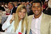 From left, Ashton Meem and her husband, Seahawks quarterback  Russell Wilson, enjoy 2013 Medical Teams International Field of Dreams fundraiser at Safeco Field in Seattle.