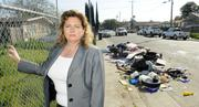 North Franklin District executive director Marti Brown stands near trash dumped on 46th Avenue. The district is trying to come up with its own community economic development plan.  From the story: North Franklin business district crafts plan for its redevelopment