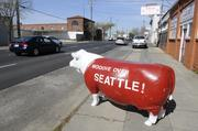 Moooove over, Seattle, says RUOFS the cow. I was on my way to an assignment when I got a smile out of RUOFS, the cow that's a fixture out in front of Ruland's Used Office Furnishings Systems. The cow always has new messages on it, and I thought the message was funny, considering the situation with the Sacramento Kings. Since this photo was taken, of course, Seattle did get pushed over in favor of Sacramento.