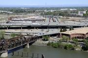 You can see a lot of stuff from here. I shot this series of photos from on top of the CalSTRS building in West Sacramento. This is an overview of the railyard and traffic in downtown Sacramento.