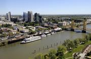 You can see a lot of stuff from here. I shot this series of photos from on top of the CalSTRS building in West Sacramento. This is a view of downtown Sacramento, old Sacramento and the Tower Bridge.