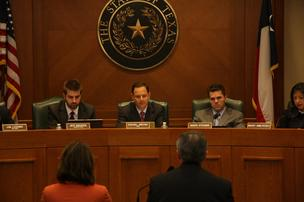 State Rep. Rafael Anchia, center, and State Rep. Mark Strama, right, listen to Janiece Longoria and Leonard Waterworth, bottom, discuss Port of Houston challenges.