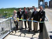 From left, Covington Mayor Sherry Carran, Hamilton County Commissioner Todd Portune, Hamilton County Commissioner Chris Monzel, Cincinnati Mayor Mark Mallory, Kentucky Transportation Cabinet District 6 Engineer Robert Hans and Ohio-Kentucky-Indiana Regional Council of Governments Executive Director Mark Policinski cut a ribbon at the opening of the new pedestrian walkway.