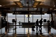 Passengers arrive at Reagan National Airport on Wednesday.