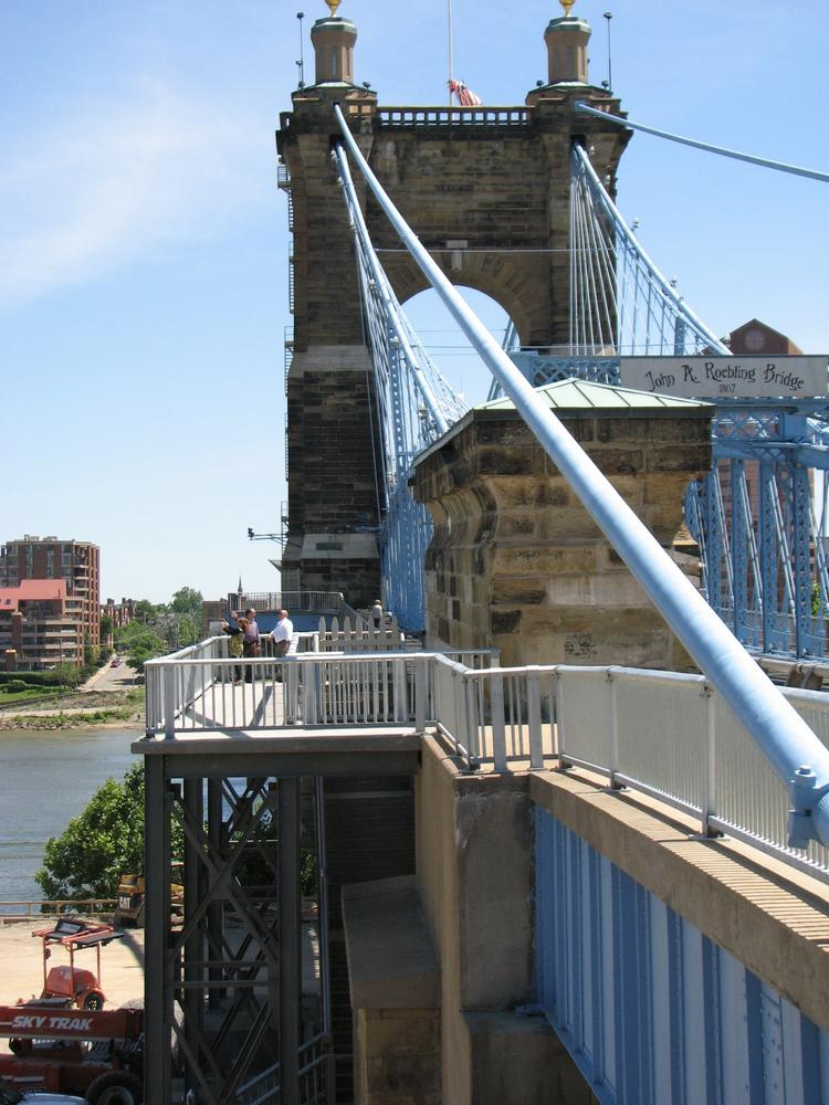 Pylons hold up the new pedestrian pathway on the east side of the Roebling Suspension Bridge.