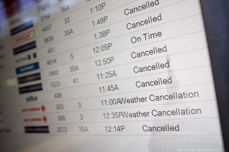 Canceled airline flights are shown on the departure board at Reagan National Airport in Washington, D.C.