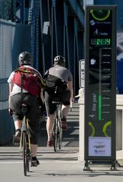 BEING COUNTED: The bike counter on Seattle's Fremont Bridge shows more than 1,400 cyclists had used the bridge by 9 a.m. on a Tuesday morning.  The bridge is a popular route into downtown for bike commuters.