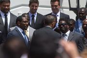 President Barack Obama speaks with Ray Lewis, left, and Ed Reed, right, during a ceremony to recognize the Super Bowl champion Baltimore Ravens on the South Lawn of the White House on Wednesday afternoon.