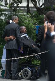 President Barack Obama meets with O.J. Brigance after a ceremony to recognize the Super Bowl champion Baltimore Ravens on the South Lawn of the White House on Wednesday afternoon.