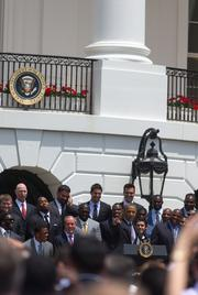 President Barack Obama gestures to a Chicago Bears fan as he recognizes the Super Bowl champion Baltimore Ravens on the South Lawn of the White House on Wednesday afternoon.