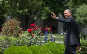 President Barack Obama waves as he leaves the ceremony for the Super Bowl champion Baltimore Ravens on the South Lawn of the White House on Wednesday afternoon.