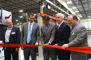 Officials, including N.C. Gov. Pat McCrory in the center, celebrate the opening of Lenovo's U.S. manufacturing line with a ribbon cutting.