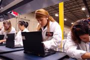 Lenovo employees snap together new computers on the company's first U.S. manufacturing line.